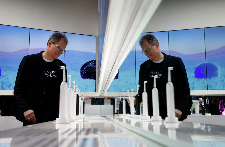 Hansjoerg Reick looks at a display of Oral-B Genius X smart toothbrushes at the Procter & Gamble booth before CES International, Monday, Jan. 7, 2019, in Las Vegas. (AP Photo/John Locher) Photo: John Locher / Copyright 2019 The Associated Press. All rights reserved.