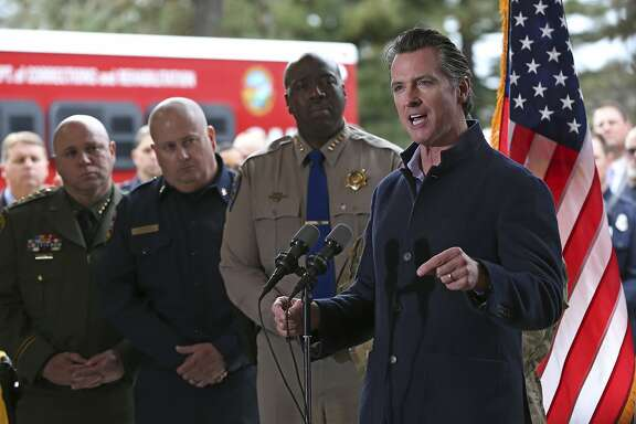 Gov. Gavin Newsom discusses emergency preparedness during a visit to the California Department Forestry and Fire Prevention CalFire Colfax station Tuesday, Jan. 8, 2019, in Colfax, Calif. On his first full day as governor, Newsom announced executive actions to improve the state's response to wildfires and other emergencies. (AP Photo/Rich Pedroncelli)