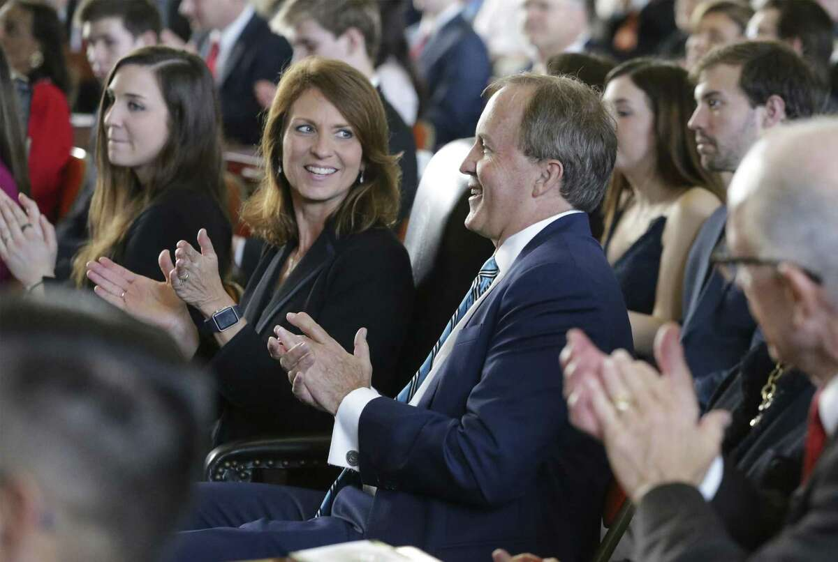 Attorney General Ken Paxton is applauded by his wife Senator Angela Paxton as the 86th State Legislature convenes on January 8, 2019.