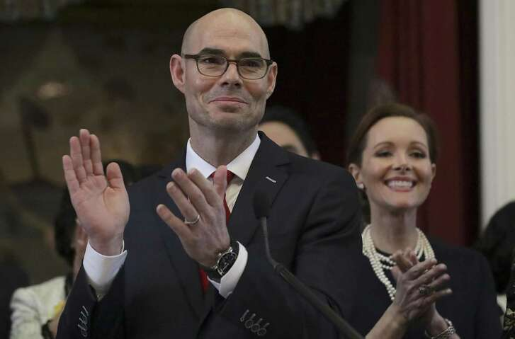 Texas House Speaker Dennis Bonnen, left, and his wife Kimberly during the opening session of the Texas House of Respresentatives on Tuesday, Jan. 8, 2019, in Austin, TX.