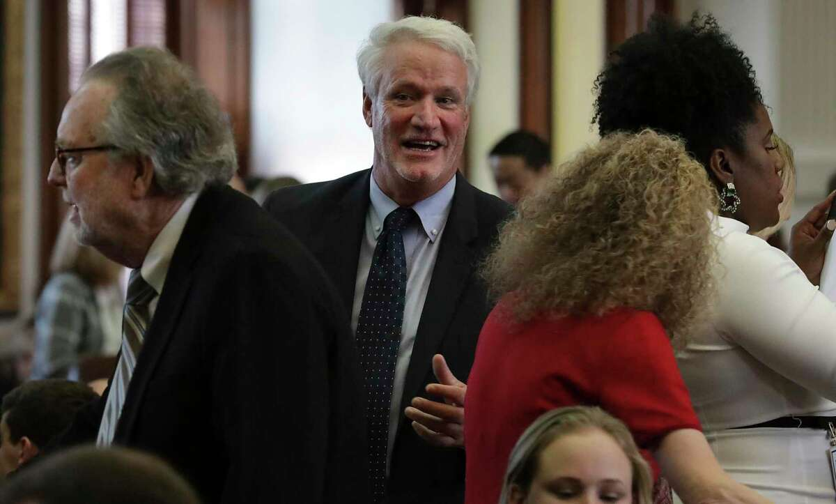 Lyle Larson of San Antonio, center, greets friends before the Texas House of Representatives meets, on Tuesday, Jan. 8, 2019, in Austin, TX.