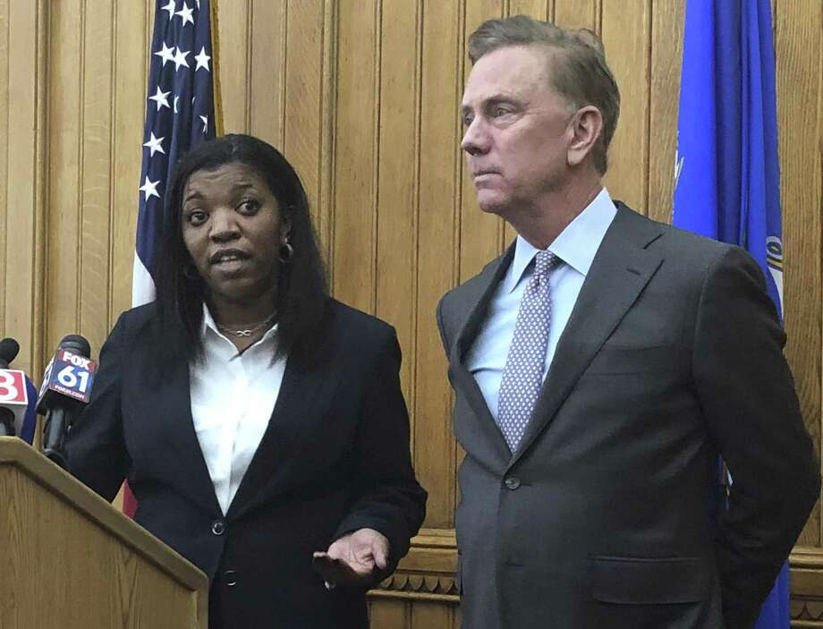 Vannessa Dorantes speaks at the Connecticut State Capitol, Monday, Jan. 7, 2019, in Hartford, following the announcement by Gov.-elect Ned Lamont, right, that she has been nominated to be the next commissioner of the Department of Children and Families. Photo: Susan Haigh / Associated Press / Copyright 2019 The Associated Press. All rights reserved.