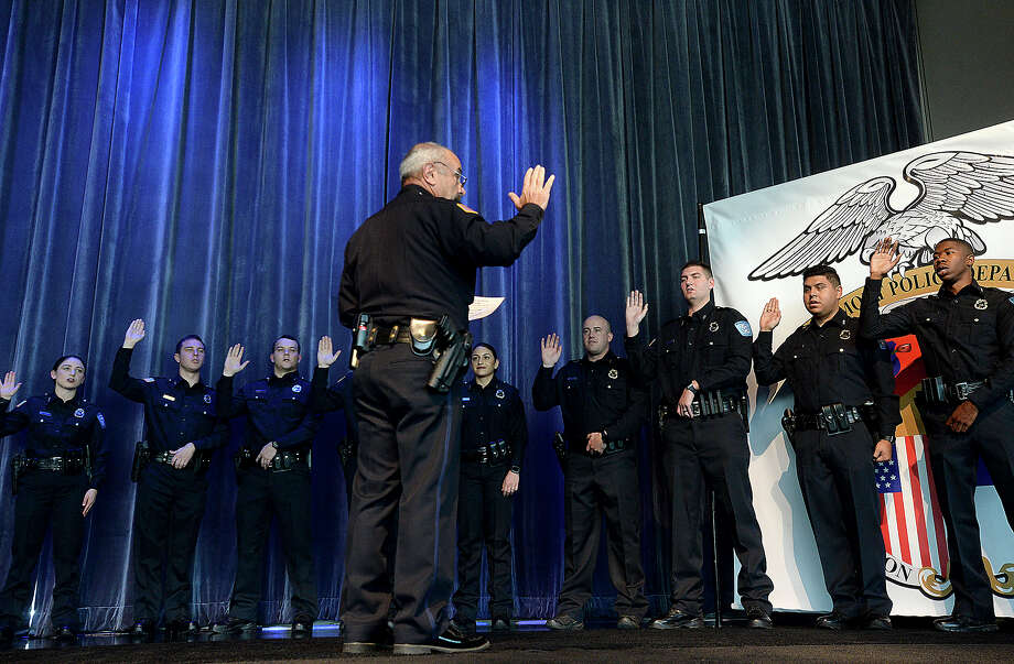 Beaumont Police Chief James Singletary delivers the oath of office to the department's twelve newest officers during a milestones ceremony Tuesday at the Event Centre. In addition to the swearing-in, officer Cody Foote was recognized for his promotion to Sergeant, and other officer and civilian awards were presented during the event. Photo taken Tuesday, January 8, 2019 Photo by Kim Brent/The Enterprise Photo: Kim Brent/The Enterprise