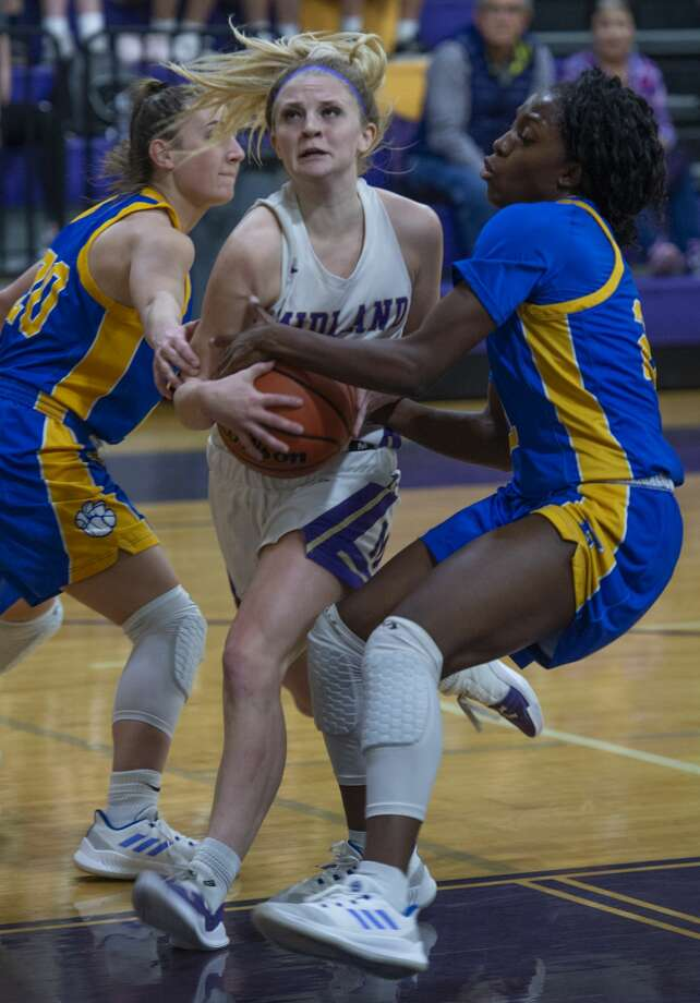 Midland High's Taysha Rushton is fouled as she tries to split Frenship defenders, Ashton Beeles and Cassandra Awatt on the way to the basket 01/08/19 at the Midland High gym. Tim Fischer/Reporter-Telegram Photo: Tim Fischer/Midland Reporter-Telegram