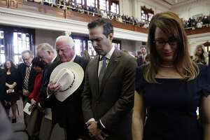 From right, Penelope Bonnen, Texas Land Commissioner George P. Bush, and Texas Agriculture commissioner Sid Miller, stand for a prayer during the opening of the 86th Texas Legislative session, Tuesday, Jan. 8, 2019, in Austin, Texas. (AP Photo/Eric Gay)