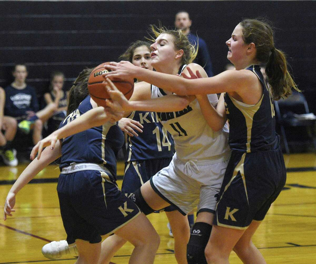 Hamden Hall's Jenna Berens, center, attempts to retain control of the ball surrounded by King's Olivia Boeckman, right, and other defenders in the high school girls basketball game between King School and Hamden Hall at King School in Stamford, Conn. Tuesday, Jan. 8, 2019.