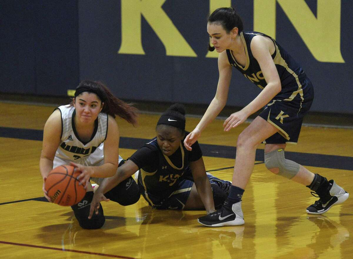 Hamden Hall's Destinee Gabriel, left, passes the ball from the floor as King's Alonna Christy, center, and Mariana McOsker defend in the high school girls basketball game between King School and Hamden Hall at King School in Stamford, Conn. Tuesday, Jan. 8, 2019.