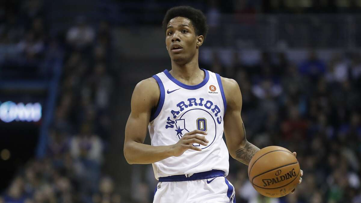 FILE - In this Jan. 12, 2018 file photo, Golden State Warriors' Patrick McCaw dribbles during the first half of an NBA basketball game against the Milwaukee Bucks in Milwaukee. McCaw is practicing with the Cavaliers, who signed him to a two-year, $6 million offer sheet last week. McCaw officially joined the Cavaliers' roster on Monday, Dec. 31 after Golden State decided not to match Cleveland's offer. (AP Photo/Morry Gash, File)
