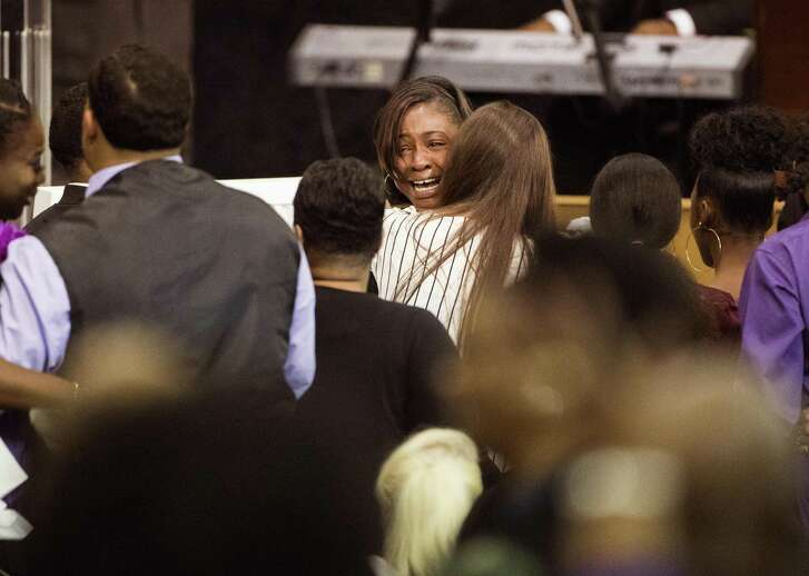 LaPortia Washington, mother of Jazmine Barnes cries by the casket of her daughter during memorial service on Tuesday, Jan. 8, 2019 at the Community of Faith Church in Houston. Barnes was fatally shot, Dec. 30, 2019, while in a car with her family during an attack that investigators say appears to be a case of mistaken identity. (Marie De Jesus/Houston Chronicle via AP)