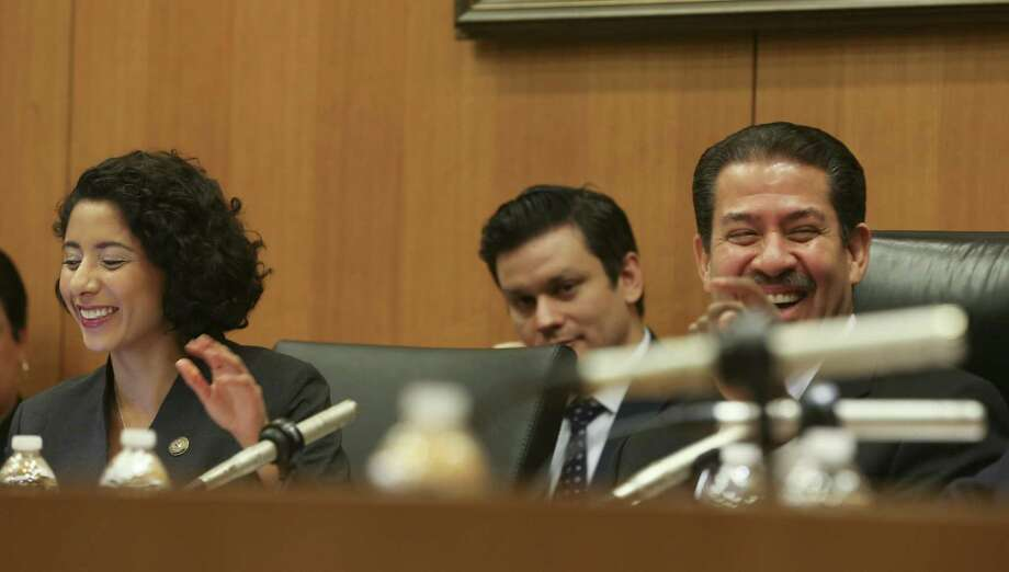 Newly-elected Harris County Judge Lina Hidalgo laughs with Commissioner Adrian Garcia during her first Harris County Commissioners Court meeting on Tuesday, January 8, 2019 in Houston. Photo: Elizabeth Conley, Houston Chronicle / Staff Photographer / © 2018 Houston Chronicle