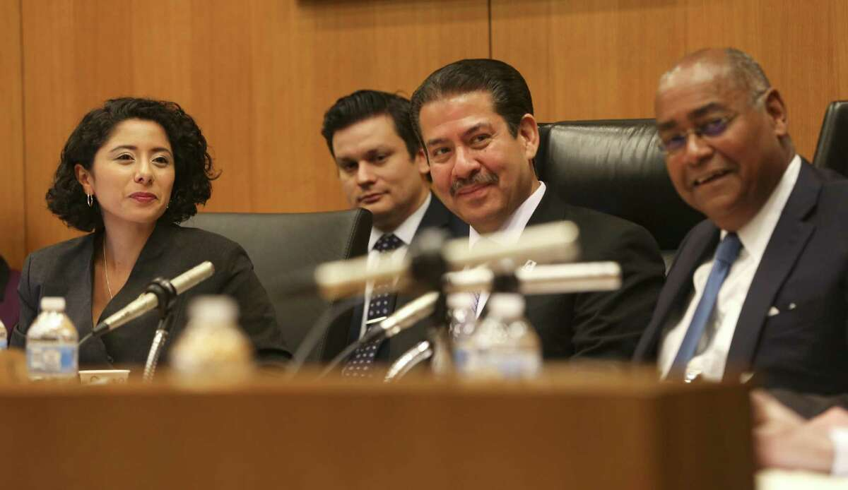 Newly-elected Harris County Judge Lina Hidalgo, left, presides over her first Harris County Commissioners Court with commissioners Adrian Garcia and Rodney Ellis on Tuesday, January 8, 2019 in Houston.