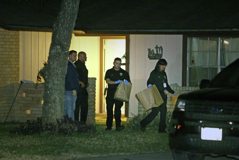 Police remove items from 5806 Castle Brook Drive on Jan. 8, 2019. The home was where Christopher Davila and his girlfriend, Jasmine Gonzales, lived with their son, King Jay Davila. The son is missing. Photo: Ronald Cortes /Contributor / 2019 Ronald Cortes