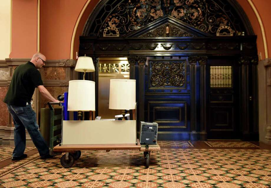 Office furniture is moved through the Capitol as lawmakers switch offices after Democrats took control of the Senate on Wednesday, Jan. 2, 2019, in Albany, N.Y. (Will Waldron/Times Union) Photo: Will Waldron