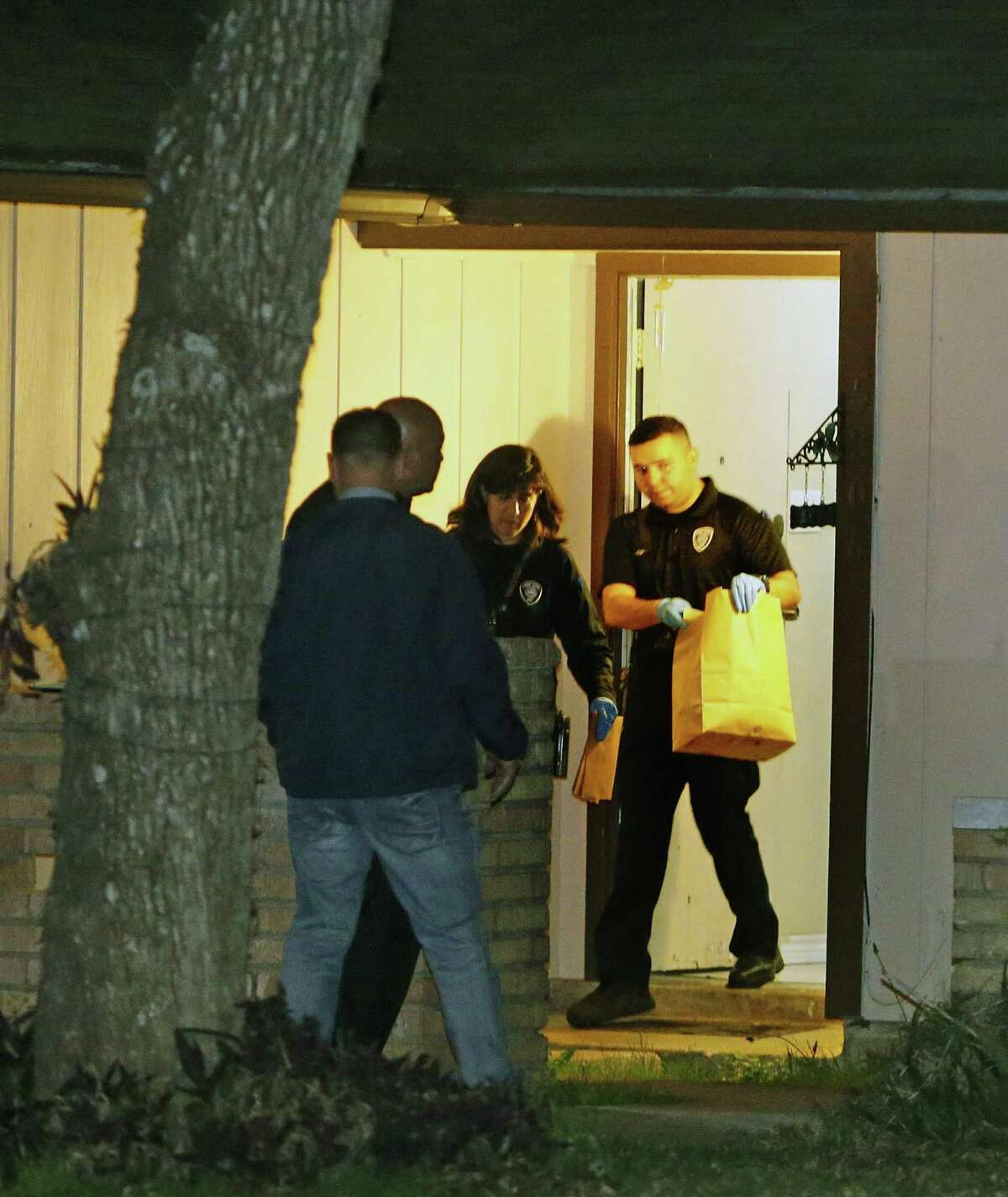 Police remove items from 5806 Castle Brook Drive on Jan. 8, 2019. The home was where Christopher Davila and his girlfriend, Jasmine Gonzales, lived with their son, King Jay Davila. The son is missing.