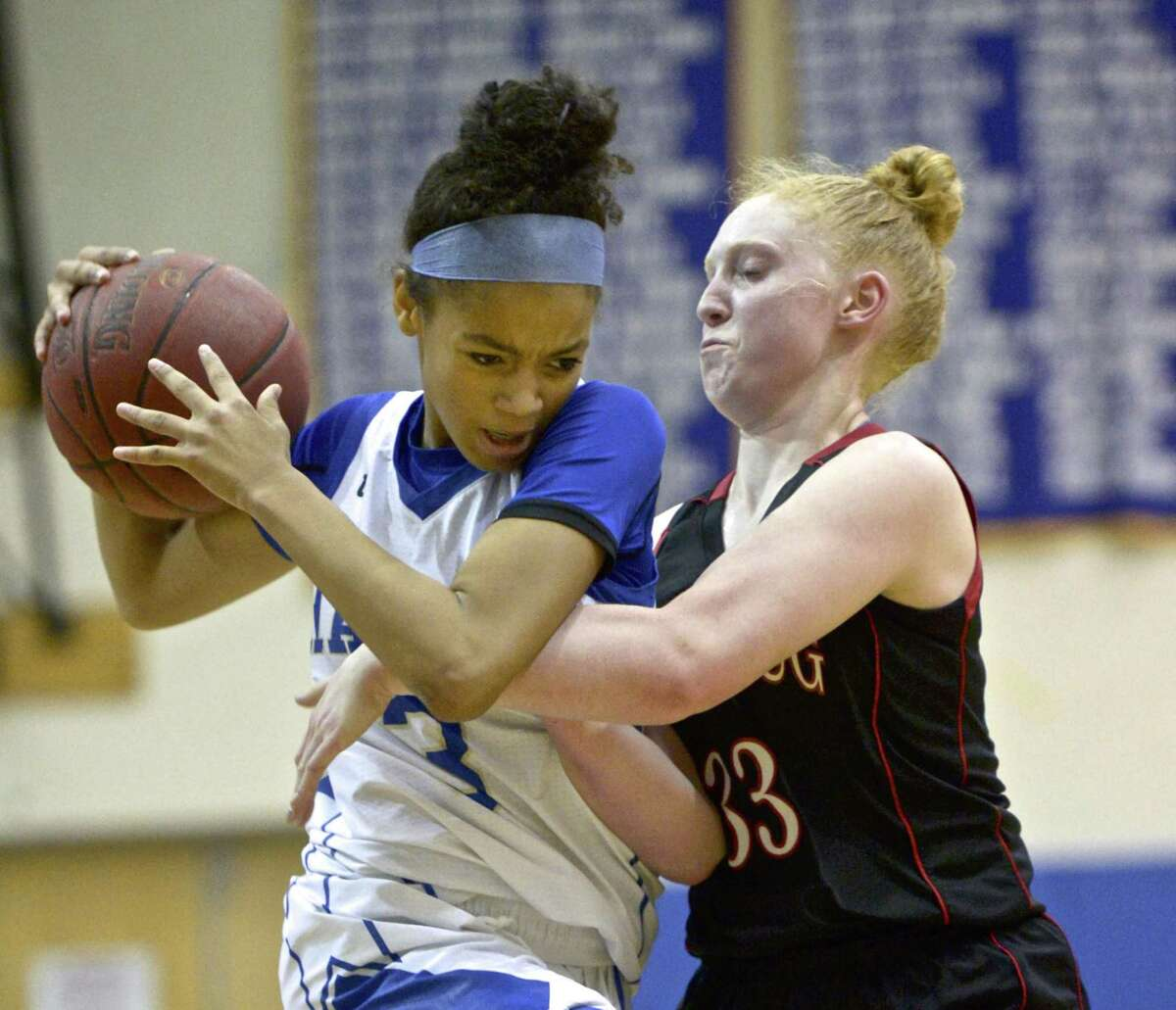 Newtown's Amy Sapenter (3) is fouled by Pomperaug's Maggie Lee (33) as she drives to the basket in the girls basketball game between Pomperaug and Newtown high schools, Tuesday night, January 8, 2019, at Newtown High School, Newtown, Conn.
