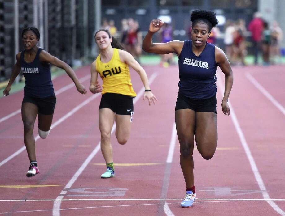 Hillhouse's Ayesha Nelson, right, places first in the first heat of the 55-meter run at the SCC Indoor Track Developmental meet at the Floyd Little Athletic Center in New Haven on Tuesday. Photo: Arnold Gold / Hearst Connecticut Media / New Haven Register
