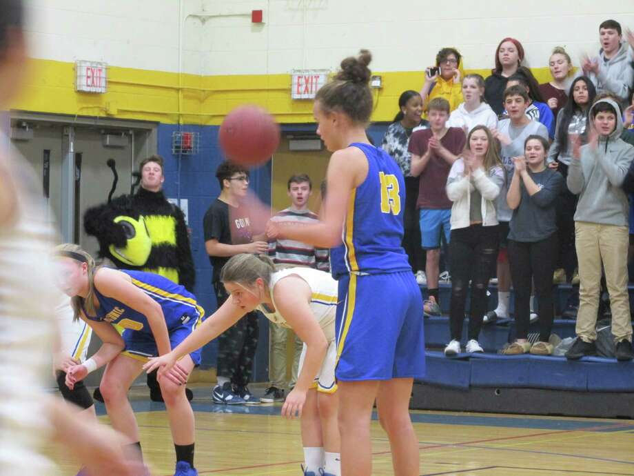 Housatonic freshman Sydney Segalla, at the foul line, had a big hand in a Mountaineer defense that kept the Yellowjackets in check Tuesday night at The Gilbert School. Photo: Peter Wallace / Hearst Connecticut Media