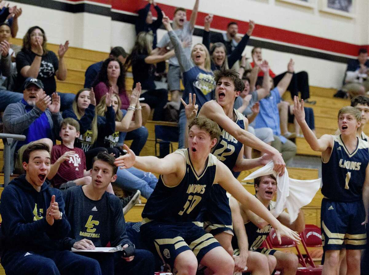 Lake Creek players and fans react after a three-pointer by shooting guard Mason Moore during the third quarter of a District 20-5A high school basketball game at Caney Creek High School, Tuesday, Jan. 8, 2019, in Grangerland.