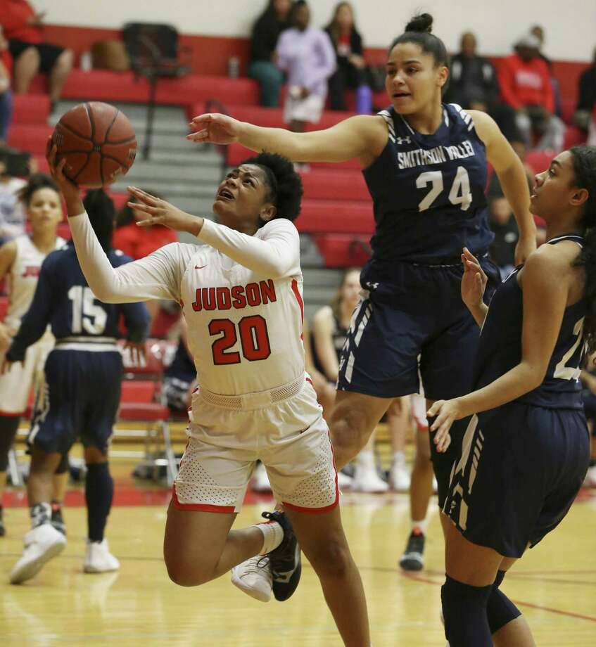 Judson's Kierra Sanderlin (20) goes up for a shot against Smithson Valley's Tanyse Moehrig (24) in 26-6A girls basketball at Judson on Tuesday, Jan. 8, 2019. The Rockets defeated the Rangers, 64-48, to stay undefeated in district play. The win also marked the 300th victory for Judson coach Triva Corrales. (Kin Man Hui/San Antonio Express-News) Photo: Kin Man Hui, Staff Photographer / San Antonio Express-News / ©2019 San Antonio Express-News