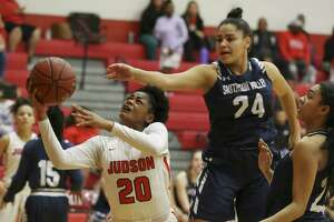 Judson's Kierra Sanderlin (20) goes up for a shot against Smithson Valley's Tanyse Moehrig (24) in 26-6A girls basketball at Judson on Tuesday, Jan. 8, 2019. The Rockets defeated the Rangers, 64-48, to stay undefeated in district play. The win also marked the 300th victory for Judson coach Triva Corrales. (Kin Man Hui/San Antonio Express-News)