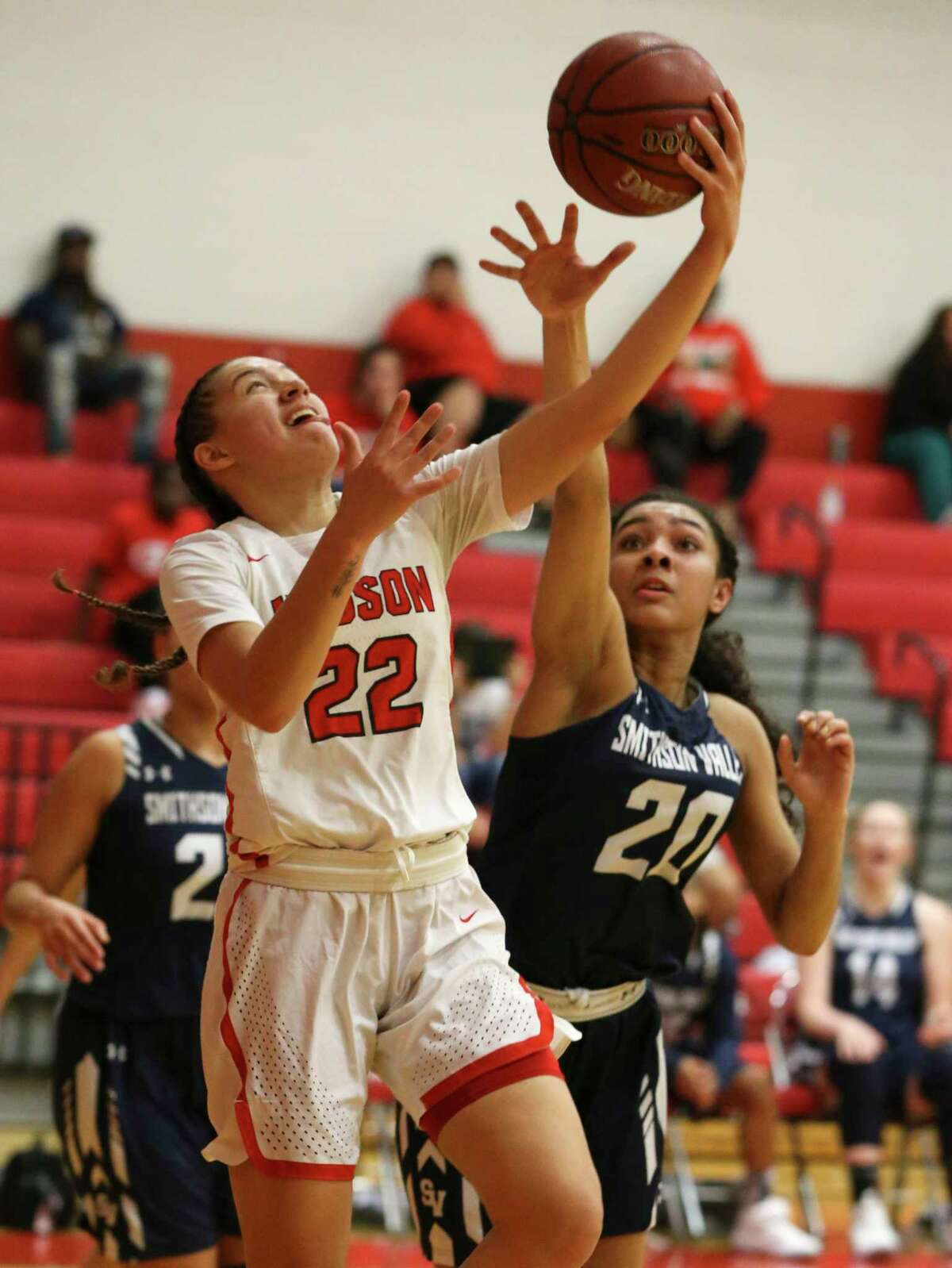 Judson's Kyra White (22) goes up for shot against Smithson Valley's Anika McGarity (20) in 26-6A girls basketball at Judson on Tuesday, Jan. 8, 2019. The Rockets defeated the Rangers, 64-48, to stay undefeated in district play. The win also marked the 300th victory for Judson coach Triva Corrales. (Kin Man Hui/San Antonio Express-News)