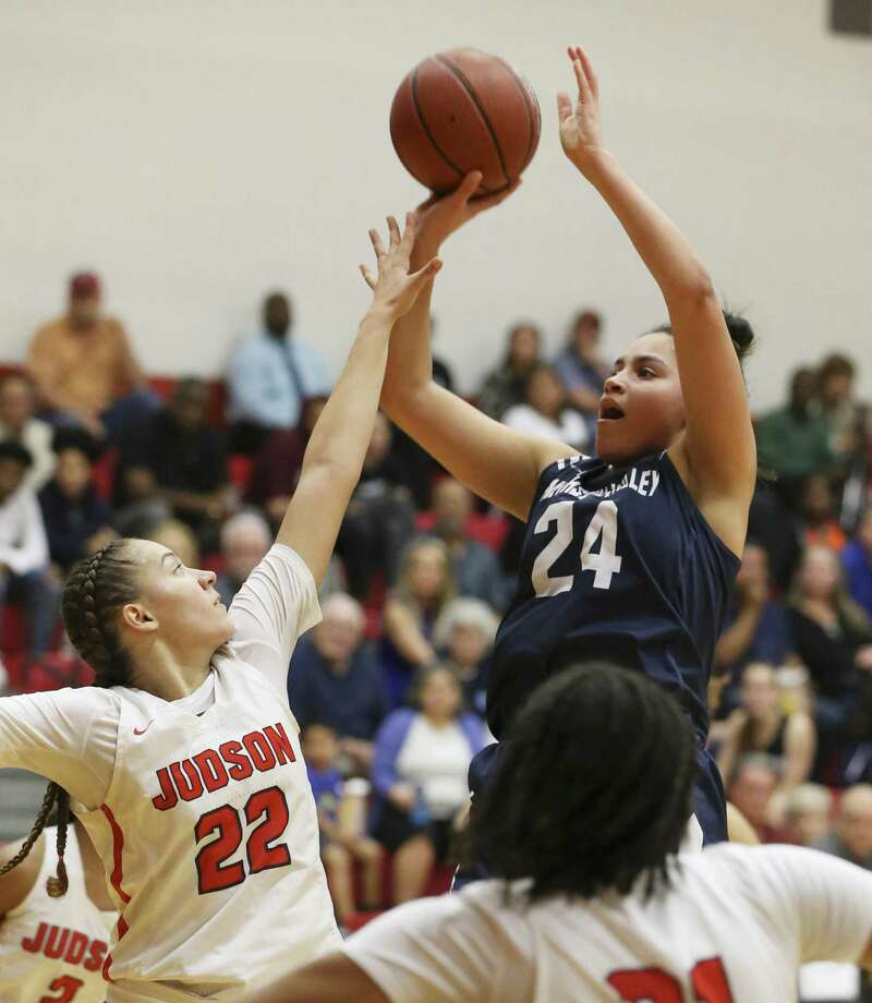 Judson's Kyra White (22) defends against Smithson Valley's Tanyse Moehrig (24) in 26-6A girls basketball at Judson on Tuesday, Jan. 8, 2019. The Rockets defeated the Rangers, 64-48, to stay undefeated in district play. The win also marked the 300th victory for Judson coach Triva Corrales. (Kin Man Hui/San Antonio Express-News) Photo: Kin Man Hui, Staff Photographer / San Antonio Express-News / ©2019 San Antonio Express-News