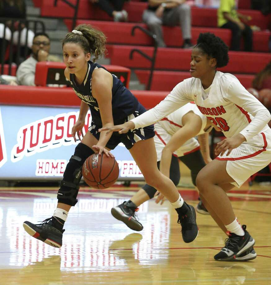 Smithson Valley's Ashley Adaszczyk (left) pushes the ball up against Judson's Kierra Sanderlin (20) in 26-6A girls basketball at Judson on Tuesday, Jan. 8, 2019. The Rockets defeated the Rangers, 64-48, to stay undefeated in district play. The win also marked the 300th victory for Judson coach Triva Corrales. (Kin Man Hui/San Antonio Express-News) Photo: Kin Man Hui, Staff Photographer / San Antonio Express-News / ©2019 San Antonio Express-News