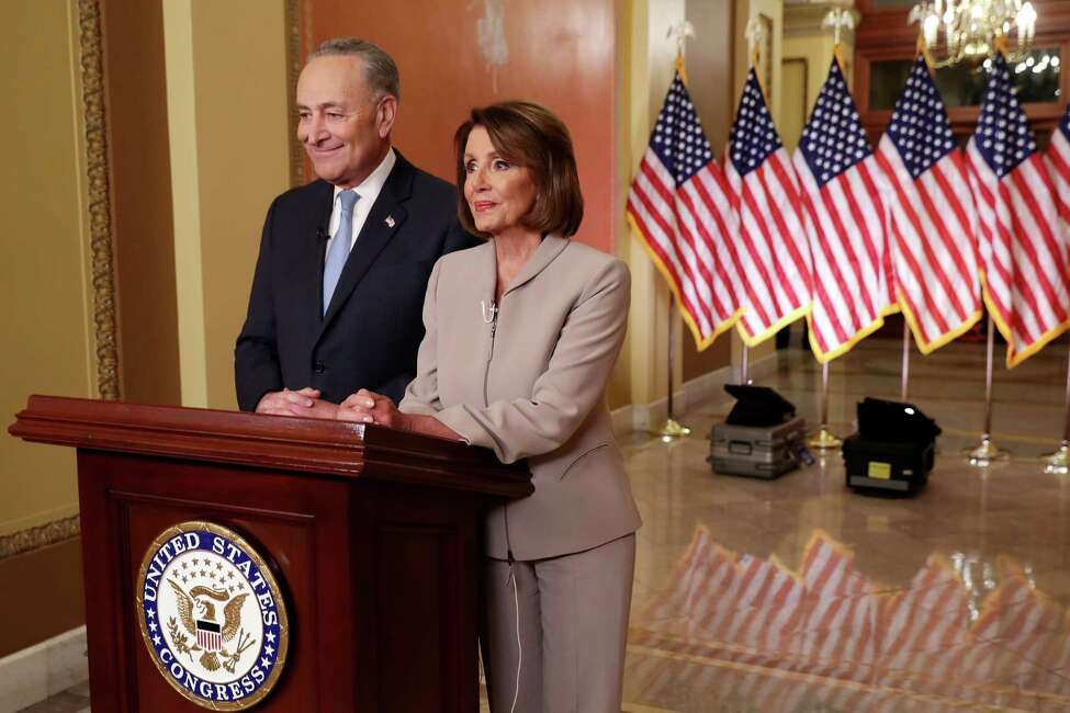 WASHINGTON, DC - JANUARY 08: Speaker of the House Nancy Pelosi (D-CA) (R) and Senate Minority Leader Charles Schumer (D-NY) pose for photographs after delivering a televised response to President Donald Trump's national address about border security at the U.S. Capitol January 08, 2019 in Washington, DC. Republicans and Democrats seem no closer to an agreement on security along the southern border and ending the partial federal government shutdown, the second-longest in history. (Photo by Chip Somodevilla/Getty Images)