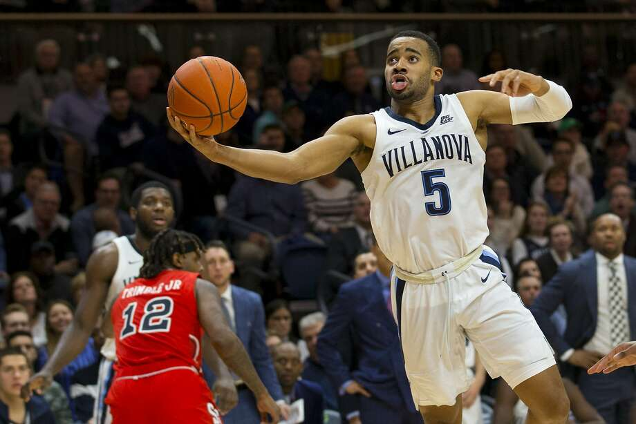 Villanova's Phil Booth scored 23 points in the Wildcats' victory over No. 24 St. John's. Booth hit six three-pointers and scored 10 points in the final seven minutes. Photo: Mitchell Leff / Getty Images