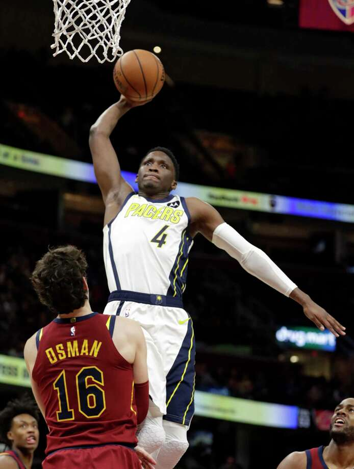 Indiana Pacers' Victor Oladipo (4) dunks against Cleveland Cavaliers' Cedi Osman (16) during the second half of an NBA basketball game Tuesday, Jan. 8, 2019, in Cleveland. The Pacers won 123-115. (AP Photo/Tony Dejak) Photo: Tony Dejak / Copyright 2019 The Associated Press. All rights reserved.