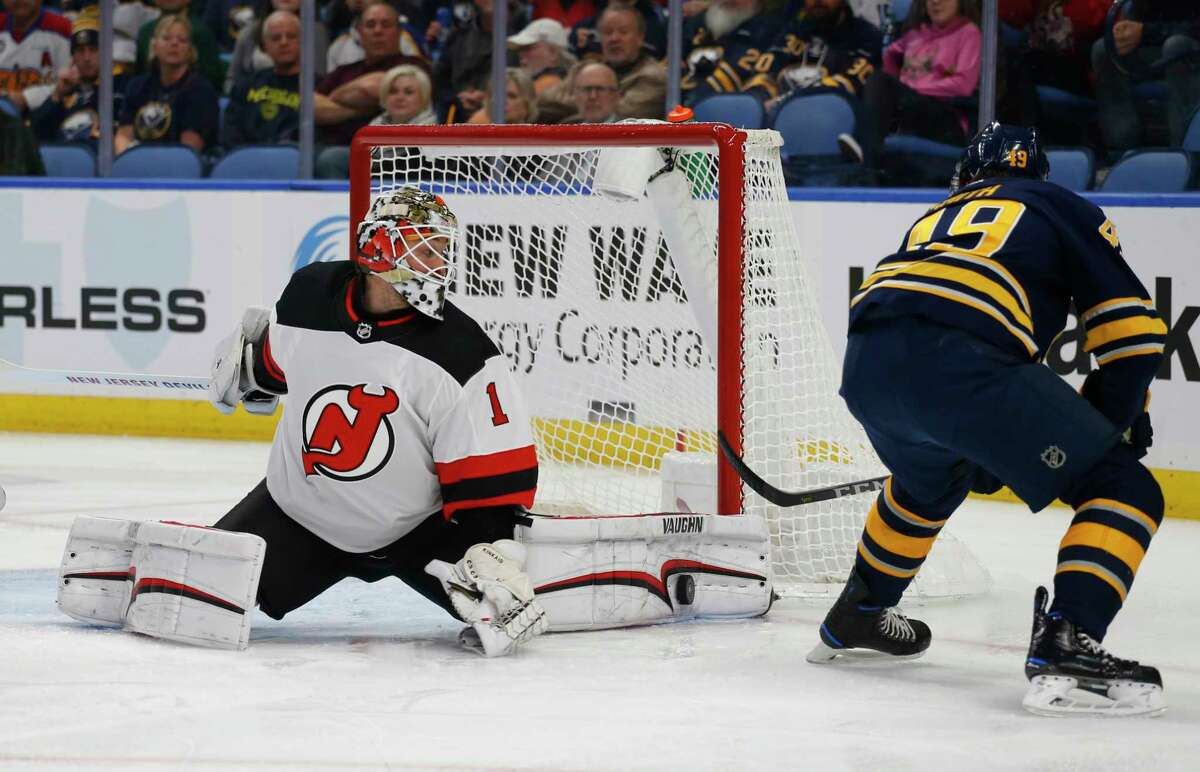 Buffalo Sabres forward C.J. Smith (49) is stopped by New Jersey Devils goalie Keith Kinkaid (1) during the first period of an NHL hockey game, Tuesday, Jan. 8, 2019, in Buffalo N.Y. (AP Photo/Jeffrey T. Barnes)