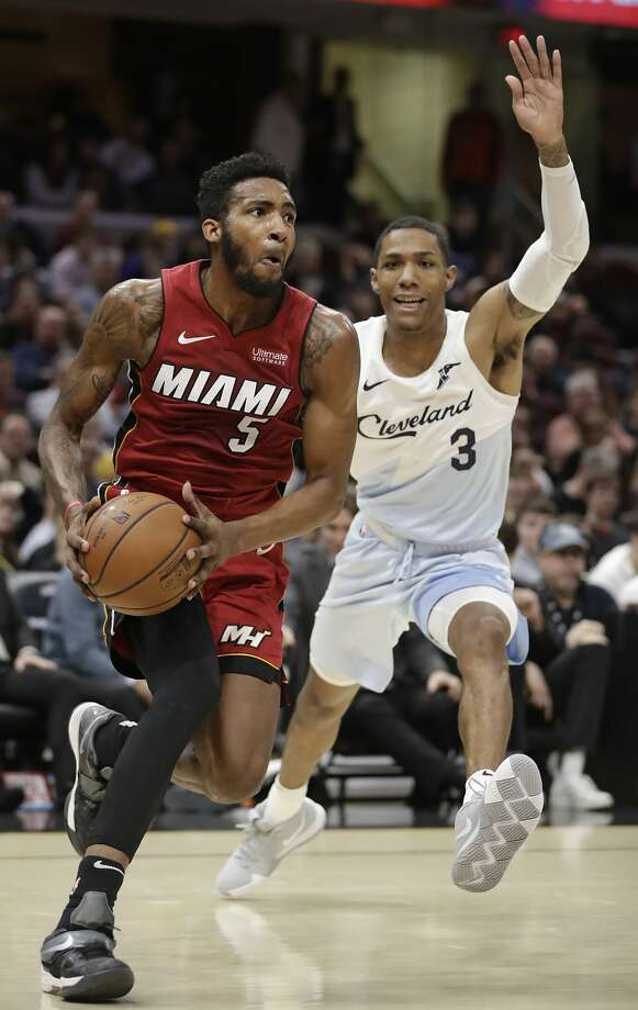 The Heat's Derrick Jones Jr. drives on the Cavs' Patrick McCaw in a Jan. 2 game. Photo: Tony Dejak / Associated Press