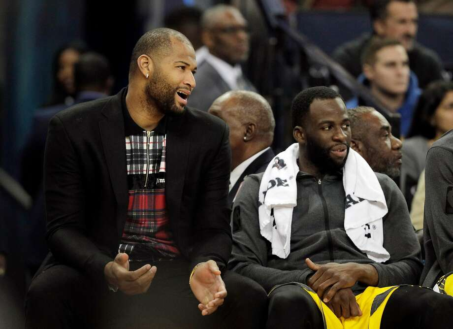 DeMarcus Cousins  chats with Draymond Green (23) on the bench in the first half as the Golden State Warriors played the New York Knicks at Oracle Arena in Oakland, Calif., on Tuesday, January 8, 2019. Photo: Carlos Avila Gonzalez / The Chronicle