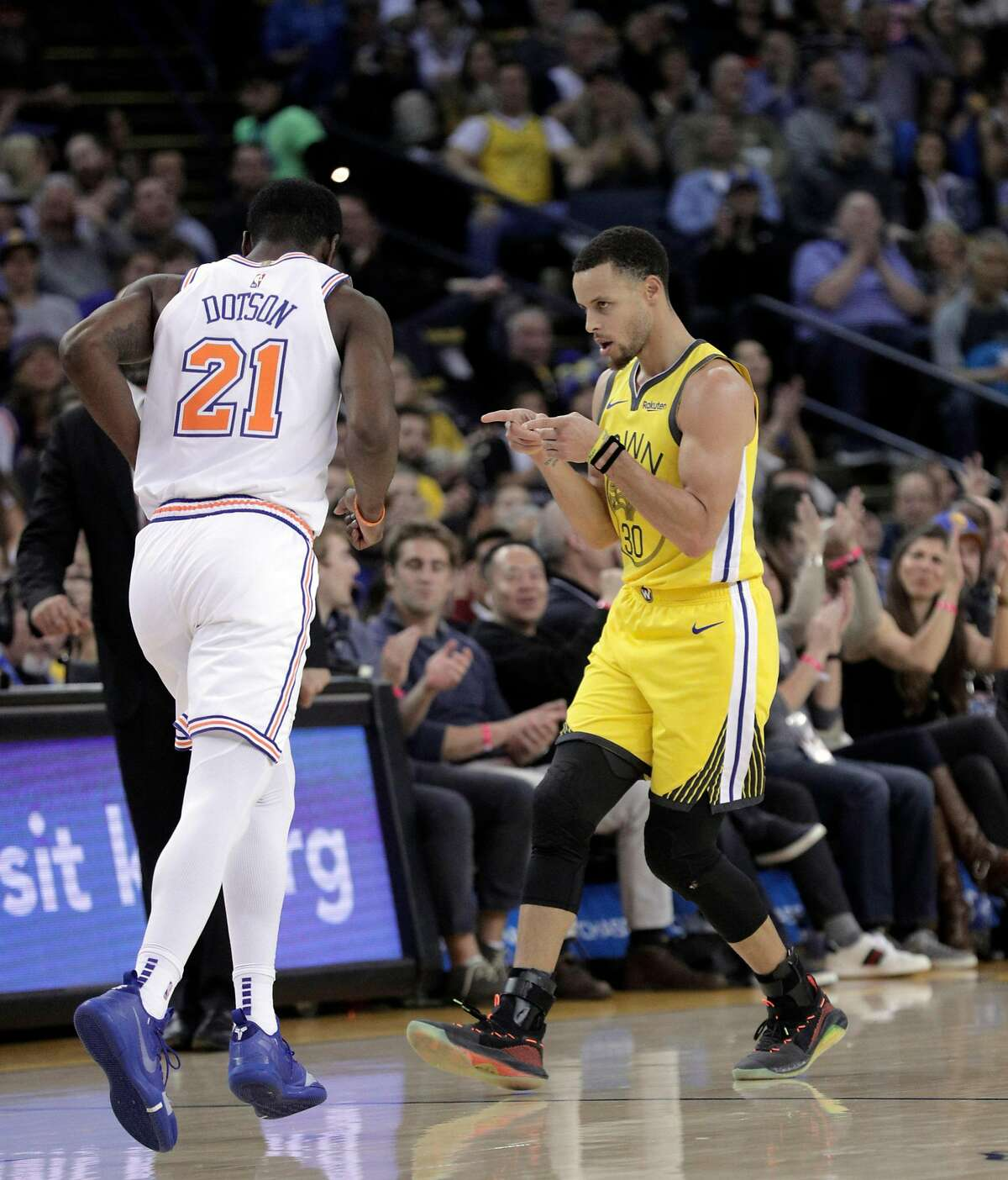Stephen Curry (30) gestures after hitting a three point shot in the first half as the Golden State Warriors played the New York Knicks at Oracle Arena in Oakland, Calif., on Tuesday, January 8, 2019.