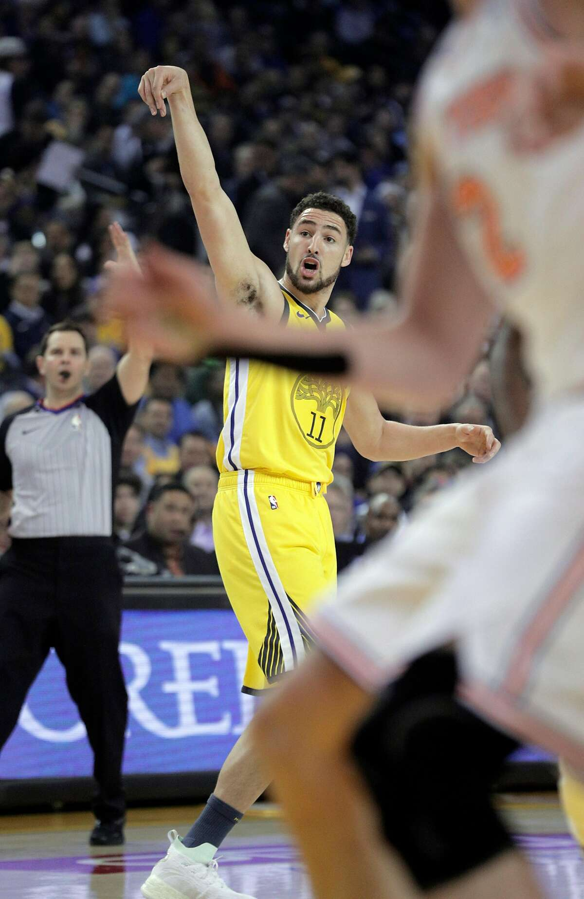 Klay Thompson (11) watches his shot go in in the first half as the Golden State Warriors played the New York Knicks at Oracle Arena in Oakland, Calif., on Tuesday, January 8, 2019.