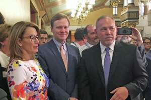 (L to R) House Minority Leader Themis Klarides, R-Derby, House Majority Leader Matt Ritter, D-Hartford, and Speaker of the House Joe Aresimowicz, D-Berlin, stood together before announcing they have reached a bipartisan agreement for a fiscal year 2019 budget adjustment at the Capitol in Hartford, Conn. on Wednesday, May 9, 2018.