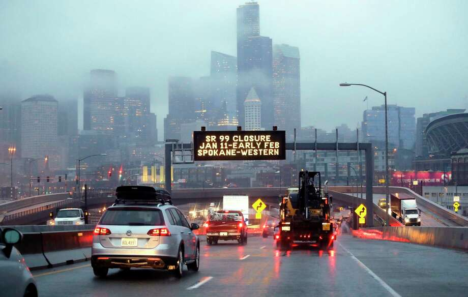 In this photo taken Thursday, Jan. 3, 2019, rush hour northbound Highway 99 traffic backs-up while heading toward the Alaskan Way Viaduct just ahead as a sign overhead advises of an upcoming closure of the roadway in Seattle. The double-decker highway along Seattle's waterfront is set to shut down for good Friday, Jan. 11, ushering in what officials say will be one of the most painful traffic periods in the city's history. The 65-year-old viaduct is being replaced by a four-lane Highway 99 tunnel, scheduled to open several weeks after the viaduct's closure. Photo: Elaine Thompson, AP / Copyright 2018 The Associated Press. All rights reserved