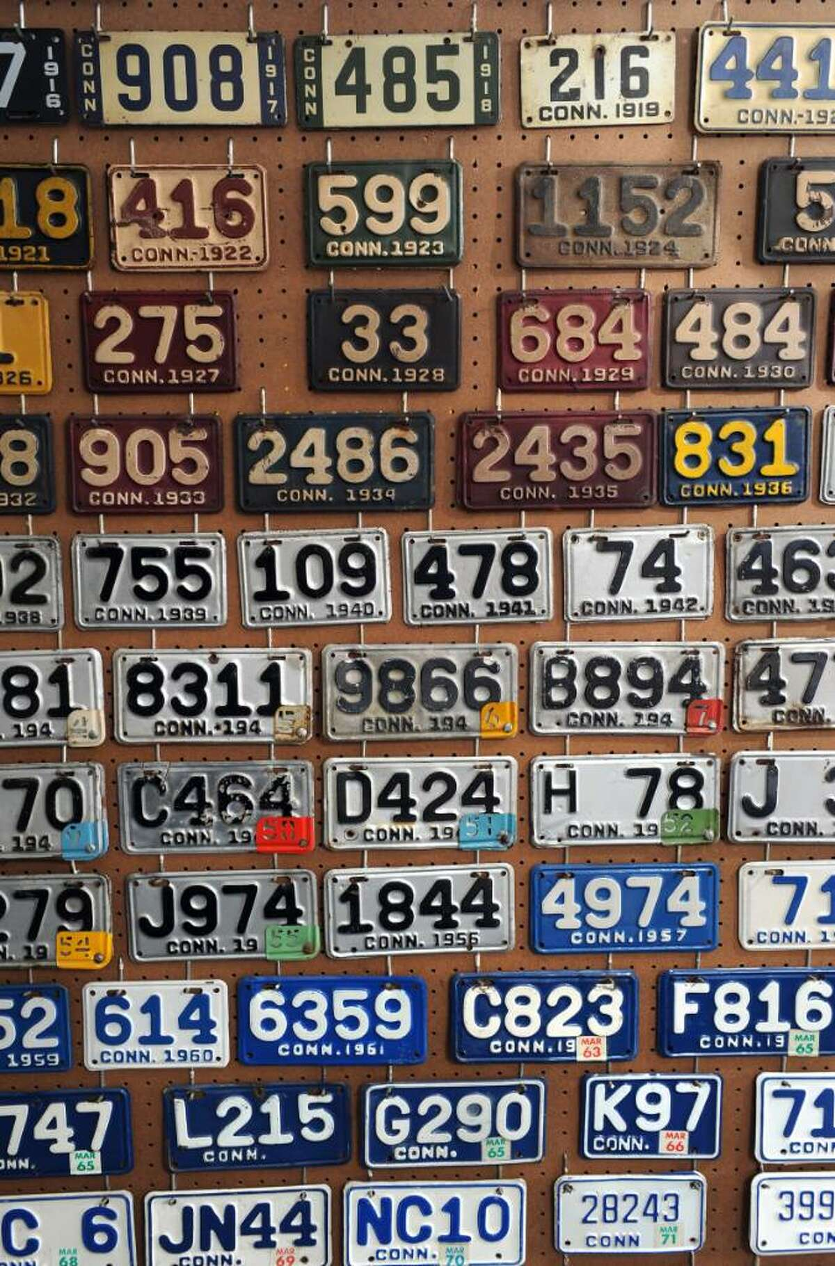 Connecticut motorcycle license plates spanning from 1912 to the present on display at David Kuehn's Milford home. Kuehn's collection of vehicle license plates numbers over 2000.