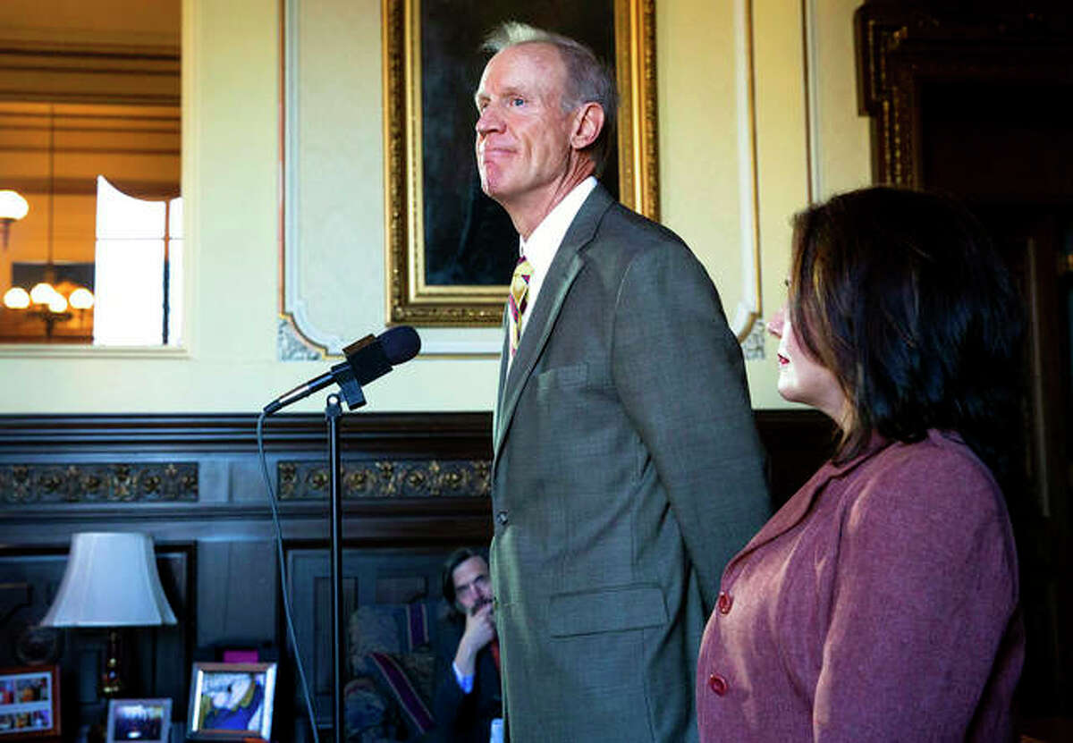Gov. Bruce Rauner looks back on his term Tuesday during a news conference with Lt. Gov. Evelyn Sanguinetti in his office at the Capitol in Springfield.