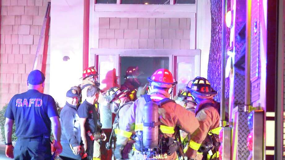 Firefighters responded to the blaze at the Coronado Apartments in the 9500 block of Lorene at about 2:41 a.m. and found a fire in a stairwell. Officials reported a strong smell of gasoline at the fire site. Photo: Ken Branca