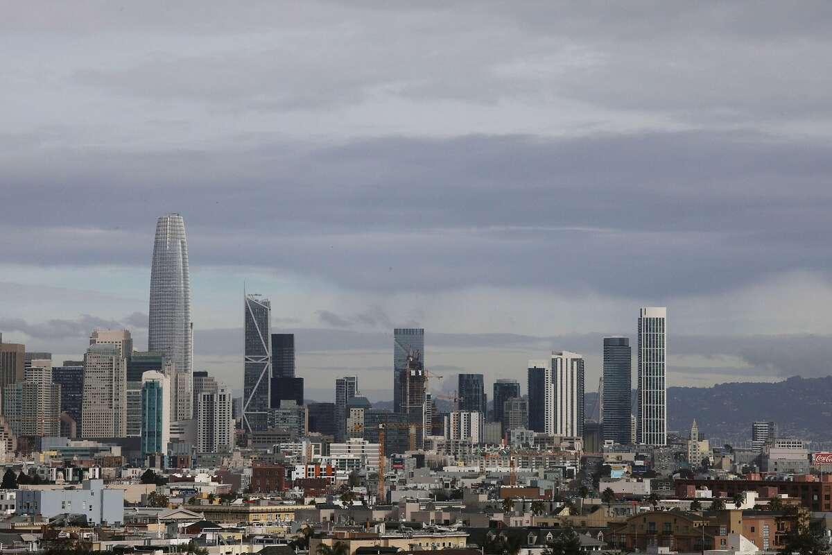 The San Francisco skyline is seen below wispy clouds on Monday, January 7, 2019 in San Francisco, Calif.