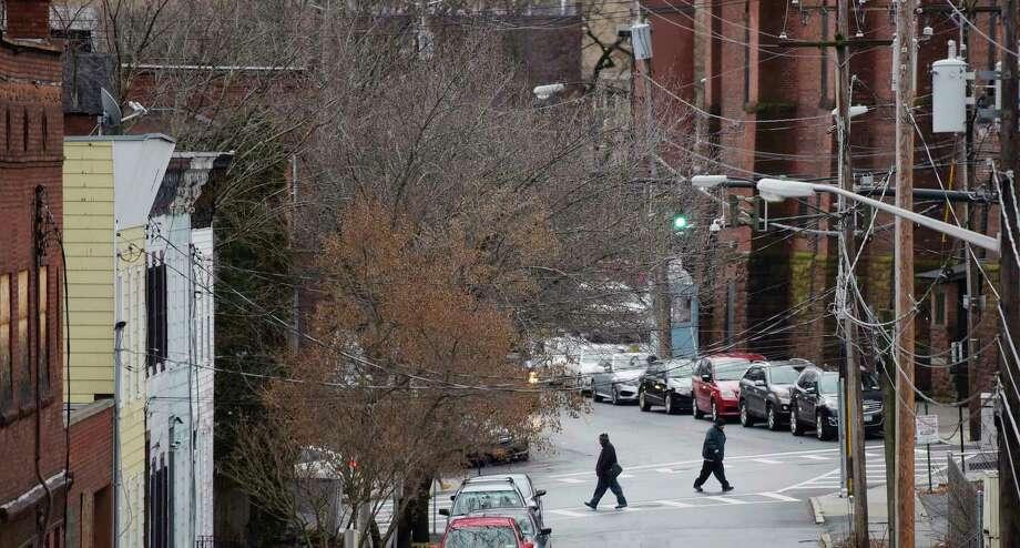 People make their way along Lark Street on Wednesday, Jan. 9, 2019, in Albany, N.Y.  (Paul Buckowski/Times Union) Photo: Paul Buckowski, Albany Times Union / (Paul Buckowski/Times Union)