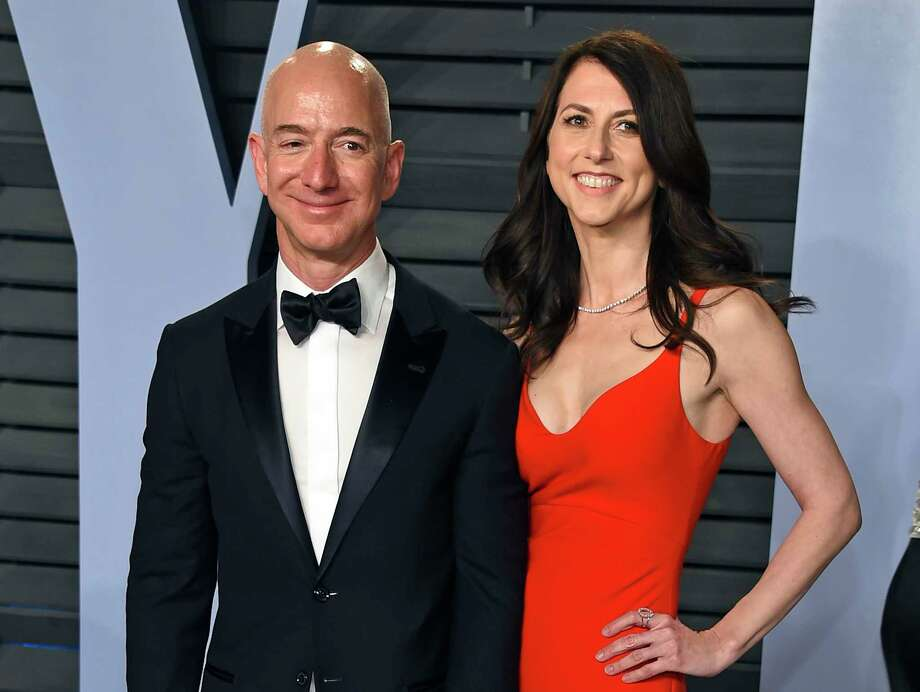 In this March 4, 2018 file photo, Jeff Bezos and wife MacKenzie Bezos arrive at the Vanity Fair Oscar Party in Beverly Hills, Calif.   Bezos says he and his wife, MacKenzie, have decided to divorce after 25 years of marriage. 