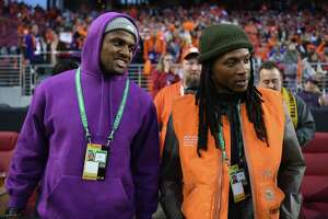 SANTA CLARA, CA - JANUARY 07:  Deshaun Watson and DeAndre Hopkins of the Houston Texans look on prior to the CFP National Championship between the Alabama Crimson Tide and the Clemson Tigers presented by AT&T at Levi's Stadium on January 7, 2019 in Santa Clara, California.