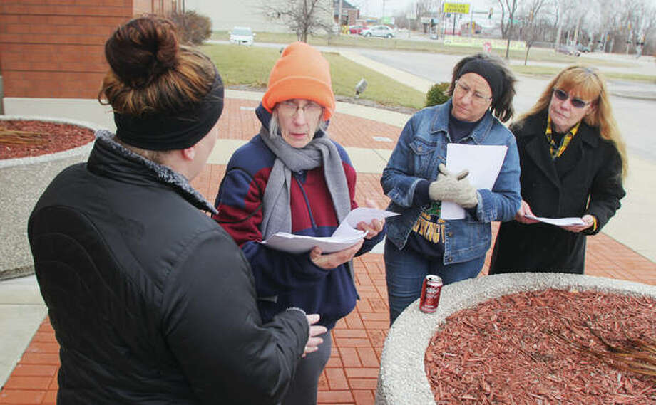 Brittany Pinnon, left, talks to volunteers Diane Martin, JoEllyn Paterson and Martha Rankin after handing out forms for last year's homeless count. The group met in front of the Donald E. Sandidge Alton Law Enforcement Center before fanning out. This year's count is set to start at 4 p.m. Monday, Jan. 28 with local volunteers again meeting at the police station.