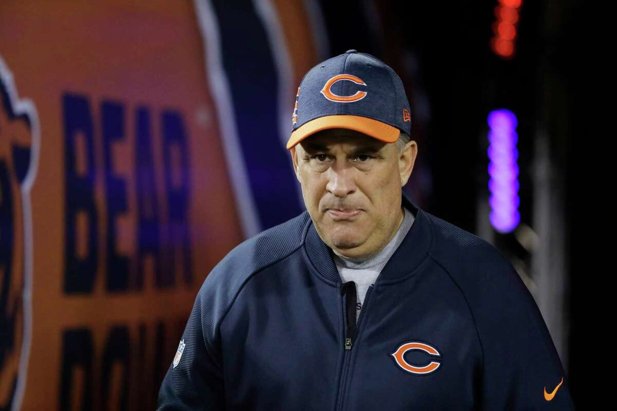 FILE - In this Dec. 9, 2018, file photo, Chicago Bears defensive coordinator Vic Fangio walks to the field before an NFL football game against the Los Angeles Rams, in Chicago. John Elway met with Bears defensive coordinator Vic Fangio about the Denver Broncos' head coaching vacancy Monday, Jan. 7, 2019, a day after Chicago's 16-15 loss to the Philadelphia Eagles in the NFC wild-card playoffs. At 60, Fangio is the oldest of the five candidates on Elway's short list as he searches for his fourth head coach in six years.(AP Photo/Nam Y. Huh, File)