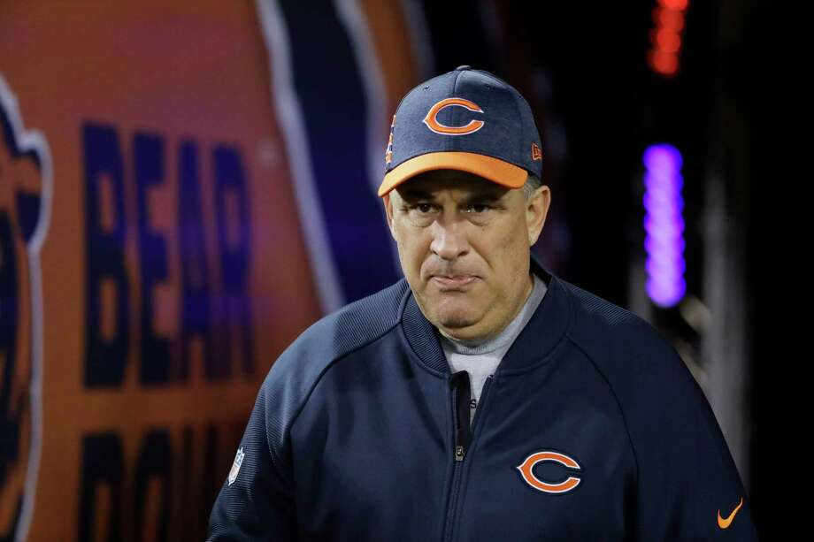FILE - In this Dec. 9, 2018, file photo, Chicago Bears defensive coordinator Vic Fangio walks to the field before an NFL football game against the Los Angeles Rams, in Chicago. John Elway met with Bears defensive coordinator Vic Fangio about the Denver Broncos' head coaching vacancy Monday, Jan. 7, 2019, a day after Chicago's 16-15 loss to the Philadelphia Eagles in the NFC wild-card playoffs. At 60, Fangio is the oldest of the five candidates on Elway's short list as he searches for his fourth head coach in six years.(AP Photo/Nam Y. Huh, File) Photo: Nam Y. Huh, Associated Press / Copyright 2018 The Associated Press. All rights reserved.
