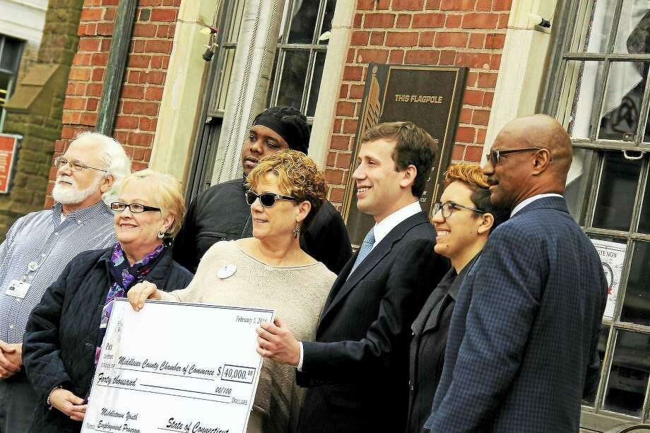 Middlesex County Chamber of Commerce partners joined state Rep. Matthew Lesser to present $40,000 to expand the Middletown Youth Employment Program. Shown in this archive photograph, from left, are David Frankel, One MacDonough Place; Suzanne Kucharski, Remax Edge; Deivon Albrincoles, who completed the jobs program; Sue Dionne, Northern Middlesex YMCA, Lesser, Elena Villafana, North End Action Team, and Lorenzo Marshall, Middlesex County Workforce Programs/Substance Abuse Council. Photo: File Photo