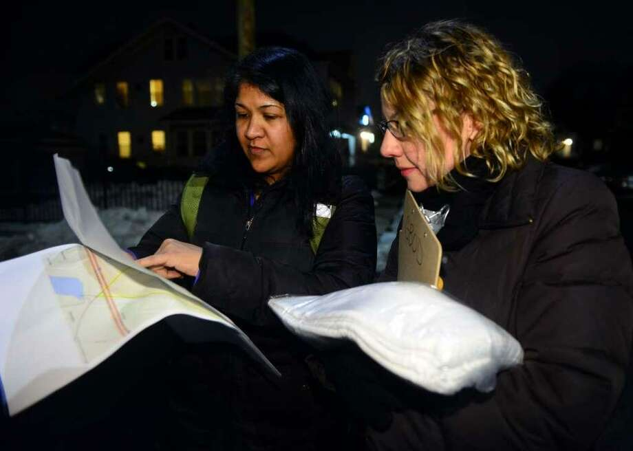 Volunteers Lisa Bahadosingh, left, and Cathy DiTuri stop to check a map as they take part in the annual Point-in-Time count in 2016. Photo: File Photo / Hearst Connecticut Media Group