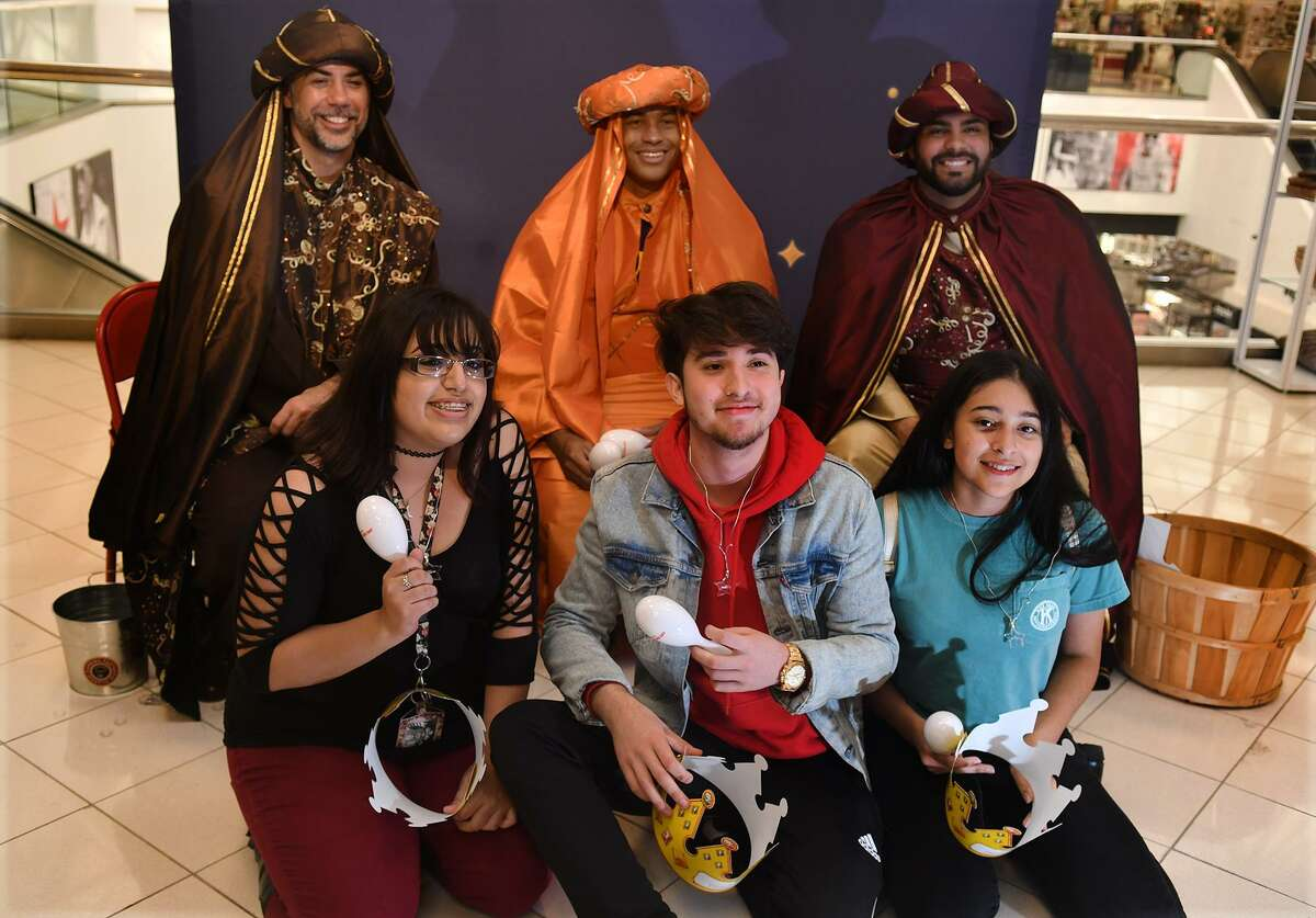 Maryuri Granda, 17, front from left, a Cy Springs High School senior, Gio Sanchez, 18, a senior at Tomball Memorial High School, and Georgia Tristan, 18, a Cy Springs High School senior, pose for a photo with the Three Kings, including